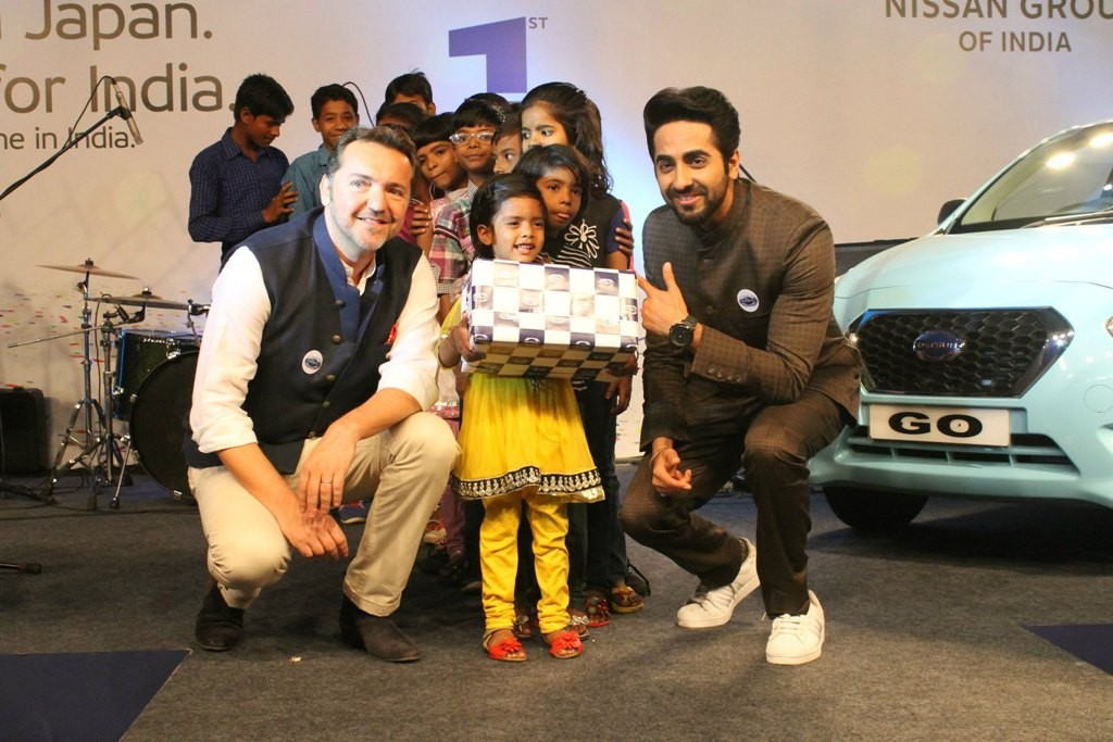 Guillaume Sicard & bollywood star Ayushmann Khurana celebrating Datsun's 1st brand anniversary with underprivileged children